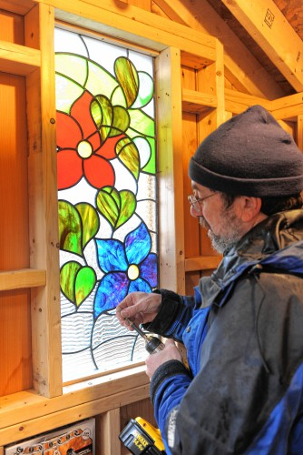 Mark Liebowitz Installs A Flower Themed Stained Glass Window Into The Garden Shed At Bridge Of Flowers In Shelburne Falls Designed By Nancy Katz