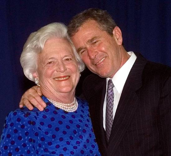 File In This JuneSembilan File Photo Texas Gov George W Bush Right Gives His Mother Barbara Bush A Hug After Taking A Family Photo In Houston