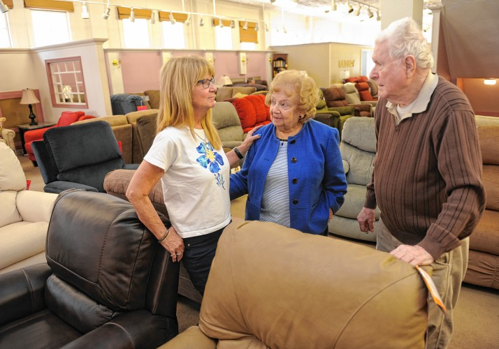 New co owner of the Home Furnishing Company Debi Roberts talks with her  parents Marcia and Stan Abrahamson  who are retiring from The Home  Furnishing. Greenfield furniture store gets handed down to next generation