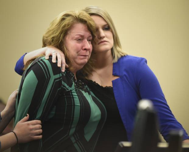 22, 2018, file photo, Krista Wakeman, right, comforts her mother after  Krista addressed Larry Nassar during the fifth day of victim impact  statements ...