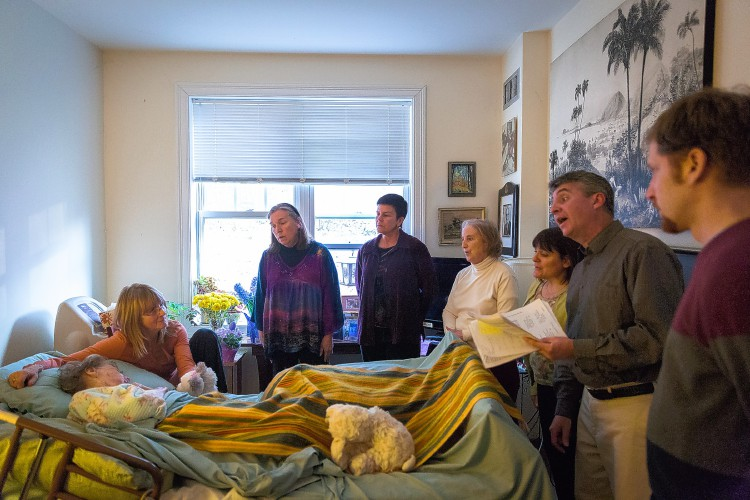 The Eventide Singers sing to 95-year-old Esther Krebs at the Arbors of Greenfield. Recorder photo.
