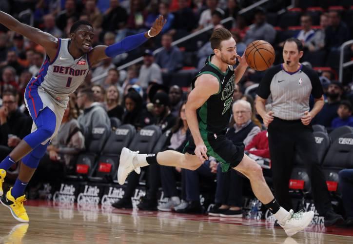 Boston Celtics forward Gordon Hayward (20) steals the ball from Detroit  Pistons guard Reggie Jackson (1) during the first half of an NBA basketball  game 79559ea6772f
