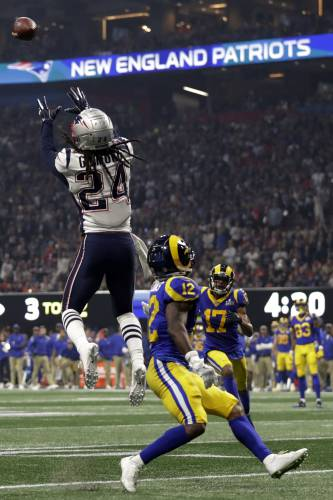 a2258430a33 New England Patriots  Stephon Gilmore (24) intercepts a pass intended for  Los Angeles Rams  Brandin Cooks (12)