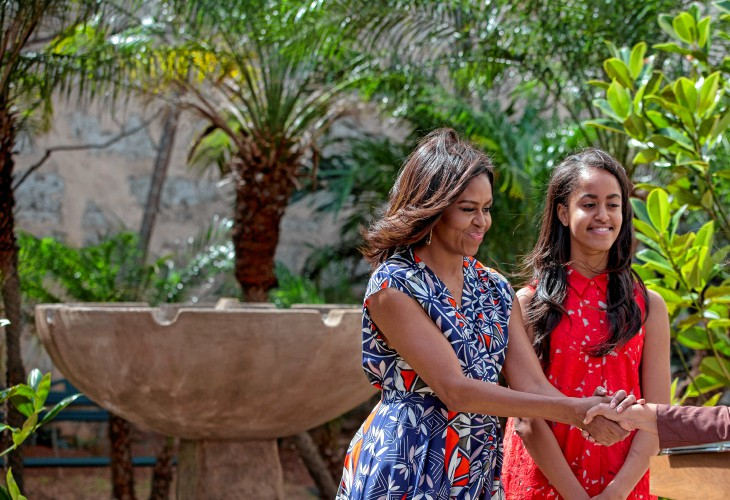 U.S. First Lady Michelle Obama, accompanied by her daughter Malia shakes  hands with Lesbia Mendez Vargas, director of cultural heritage for Havana's  Office ...