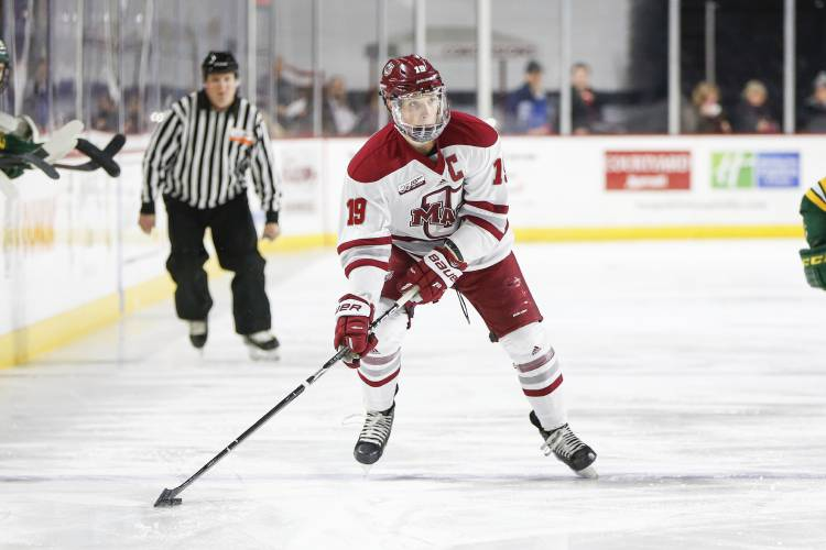 UMass Amherst forward Niko Hildenbrand Gaudet (19) moves the puck down the  ice during a NCAA hockey game against Vermont 341fee5bf