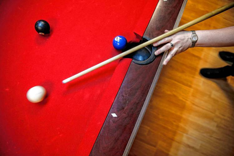 Stacie Bourbeau competes in a Franklin County Pool League match at Smitty's Pub in Greenfield. Staff Photo/Dan Little