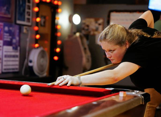 Stacie Bourbeau competes in a Franklin County Pool League match at Smitty's Pub. Staff Photo/Dan Little