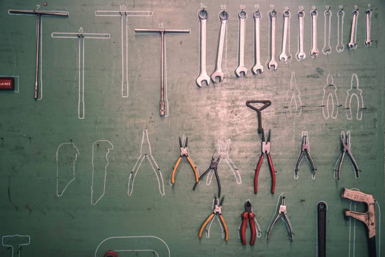 How To Organize Your Garage For Spring Organization Professionals Recommend Hanging Tools On A Wall