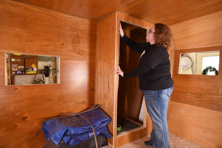 Jessica Glover Of Ashfield Puts Trim On The Toilet She And Her Husband Are Adding To Mid 1960s Yellowstone Travel Trailer Renovation