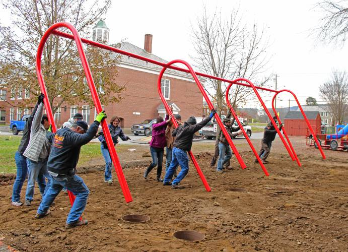 The Recorder Volunteers Install New Swing Sets At Northfield