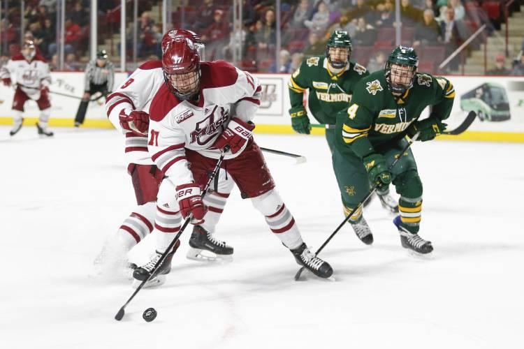 UMass Amherst forward Philip Lagunov (17) is followed by Vermont players  during a NCAA hockey game 7e36b7a7e